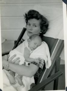 Holding my older sister, 1950.